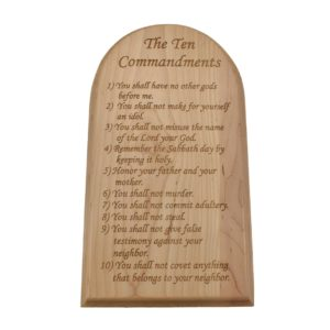 Engraved hardwood sign with an arched top and inscribed with the Ten Commandments.