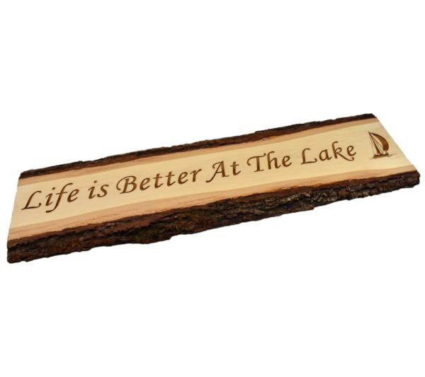 """Engraved live edge door topper sign that reads, """"Life is Better at the Lake""""."""