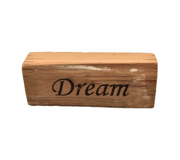 "Reclaimed barn wood block sign that reads, ""Dream""."