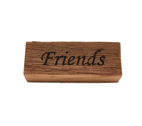"""Reclaimed barnwood sign that reads, """"Friends""""."""