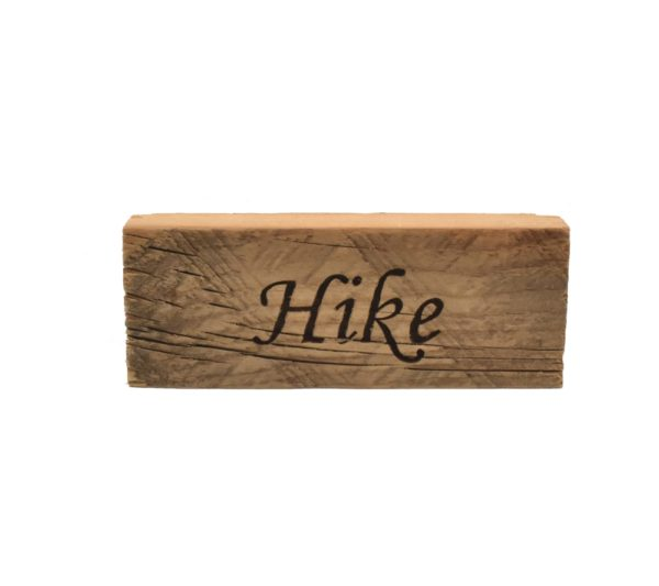 """Reclaimed barnwood sign that reads, """"Hike""""."""