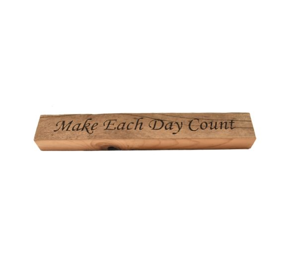 """Reclaimed barn wood block sign that reads, """"Make Each Day Count""""."""