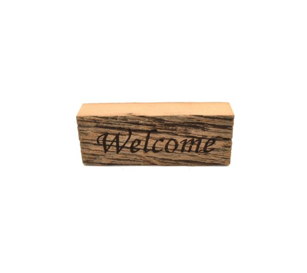 """Reclaimed barnwood sign that reads, """"Welcome""""."""