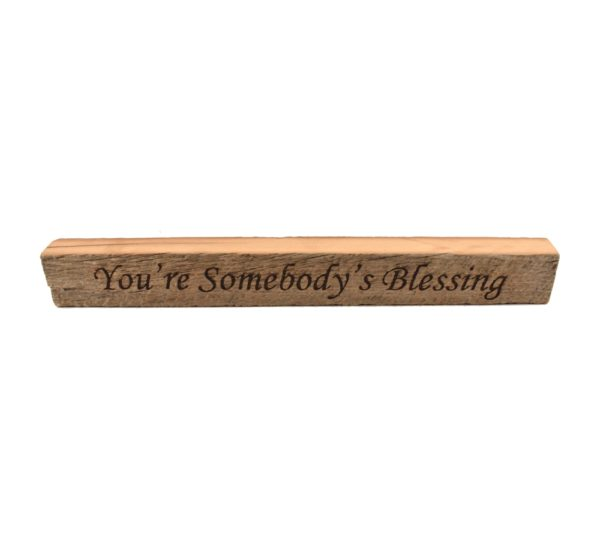 "Reclaimed barn wood block sign that reads, ""You're Somebody's Blessing""."