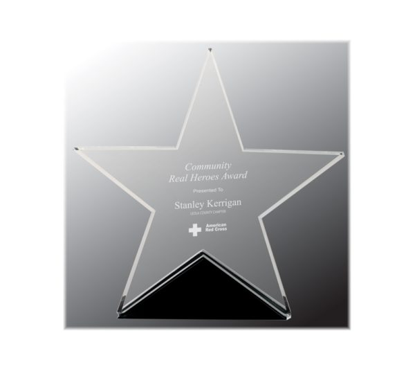 Glass star on a black base engraved as an award.