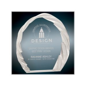 Rounded crystal award with decorative edge.