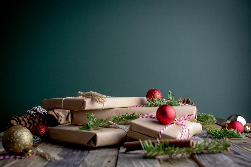 Christmas presents sitting on wooden table
